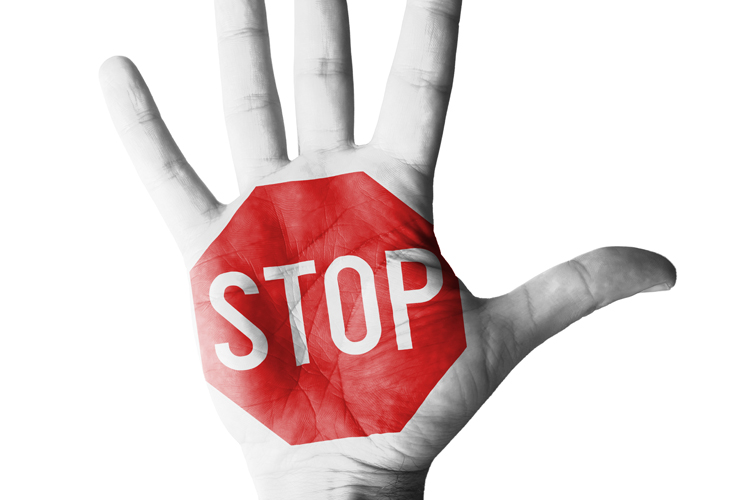 "A picture of a hand with the words ""stop"" written over the palm"
